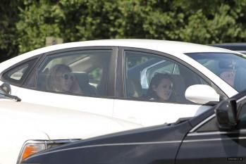 Kristen with friends in a car.